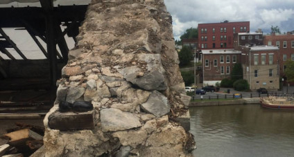 Walls coming down at former Seneca Knitting Mill