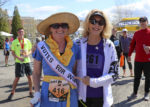 Amanda Freeland of Penfield, NY running in suffragist costume and Kathrine Switzer courtesy of  Kevin Colton Photography