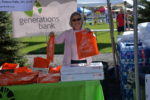 NWHF board member Marilyn Bero handing out gift bags to runners and walkers